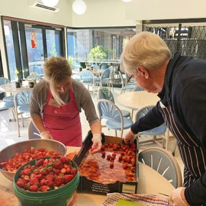 Emily Drescher and Bruce Hall food preparation at St Marys House of Welcome