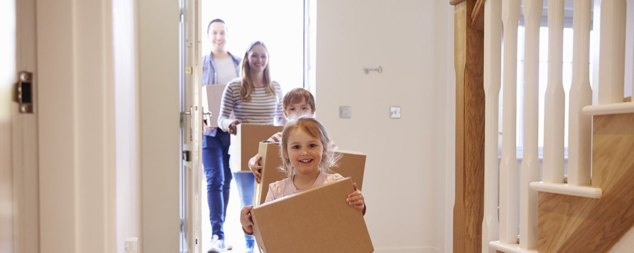 Family Moving Into New Home After Using Mortgage Finance